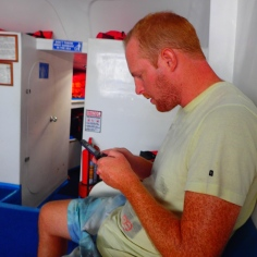 A whale, dolphins, sealions and birds all appeared during this boat trip...while Simon was determined to reach the next level in tetrus